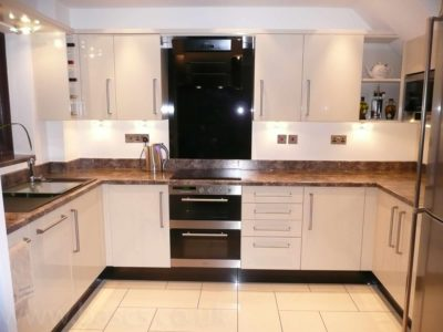 kitchen brown marble work top and white units - BASCS in Swindon