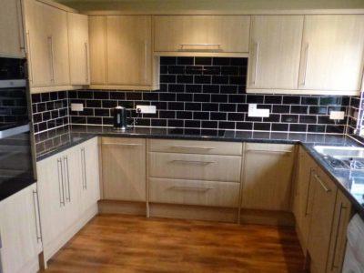 kitchen black tiles and wood doors wooden floor - BASCS swindon