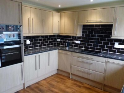kitchen black tiles and wood doors wooden floor - BASCS swindon