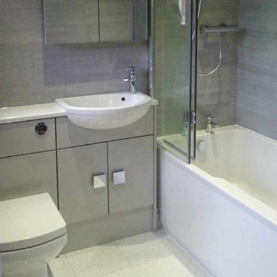 toilet, tiles and narrow bathroom sink - BASCS in Swindon